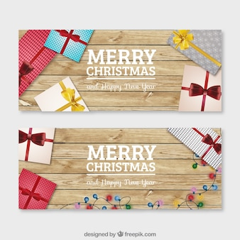 christmas gifts on a wood background banners