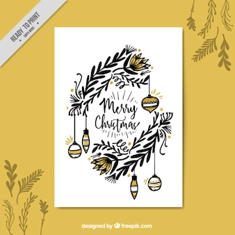 Christmas greeting with hand drawn leaves and ornaments