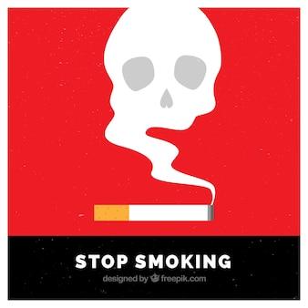 煙の頭蓋骨の背景とタバコ