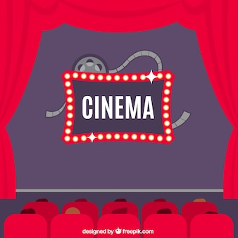 Cinema background with red curtains and armchairs