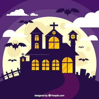 Classic haunted house with bats