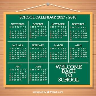 Classic school calendar on blackboard