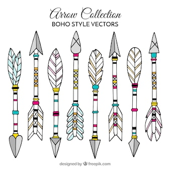 Collection of boho arrows with hand drawn feathers