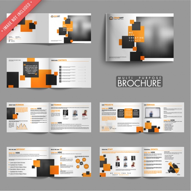 Collection of business brochures with black and orange shapes