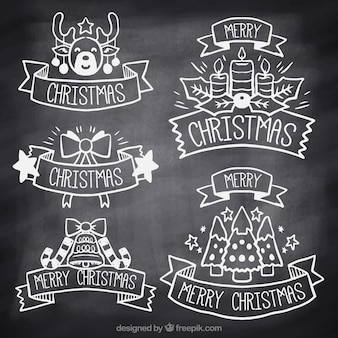 Collection of christmas stickers on blackboard effect