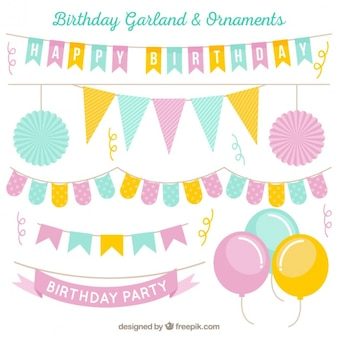 Collection of decorative birthday garlands in pastel tones