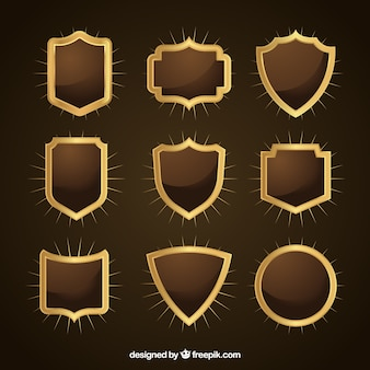 Collection of decorative golden shields