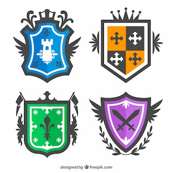 Collection of four colorful knight emblems