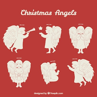Collection of hand drawn christmas angels with pretty wings