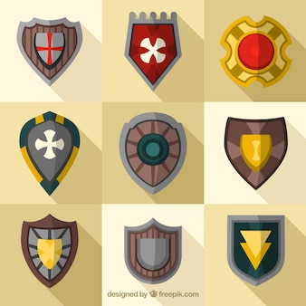 Collection of medieval shields in flat design