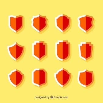 フラットなデザインの赤い盾のコレクション