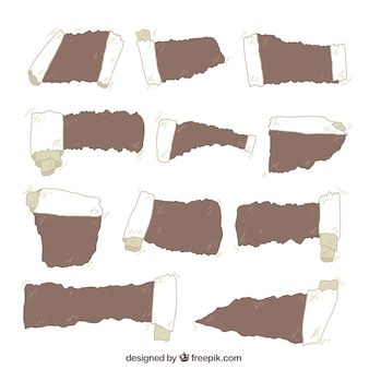 Collection of torn papers with different designs