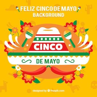 Cinco de mayoのためのメキシコの帽子の色付きの背景