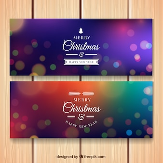 Colored bokeh banners for merry christmas and new year