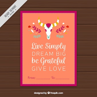 Colored greeting card with great phrase and ornamental skull