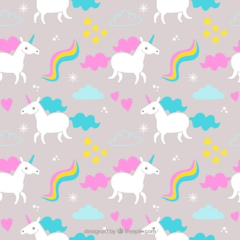 Colored unicorns pattern with elements