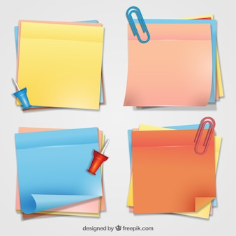 Colorful adhesive notes with some clips and thumbtacks