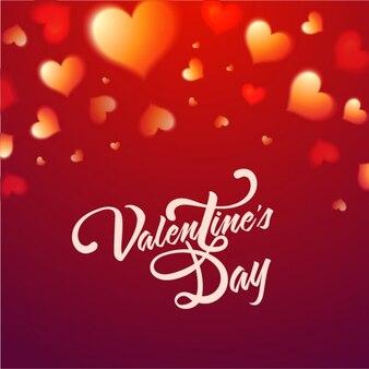 バレンタインデーのためにぼやけ心とカラフルな背景