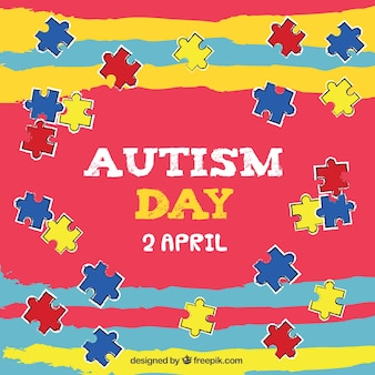 Colorful background with colored puzzle pieces for autism day