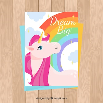 Colorful card with unicorn and rainbow