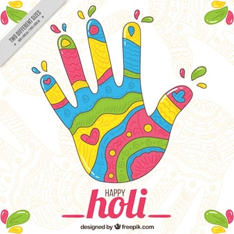 Colorful hand background for holi festival