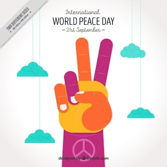 Colorful hand showing a peace symbol