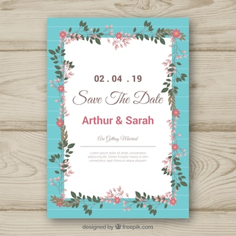 花のフレームとカラフルな結婚式の招待状