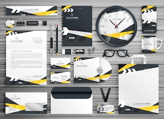 Corporate stationery set in yellow and black shapes