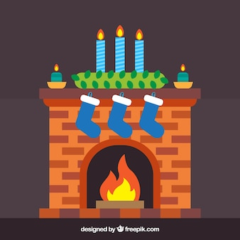 Cozy fireplace with socks and christmas candles
