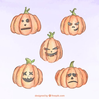 Creepy pumpkins painted with watercolors