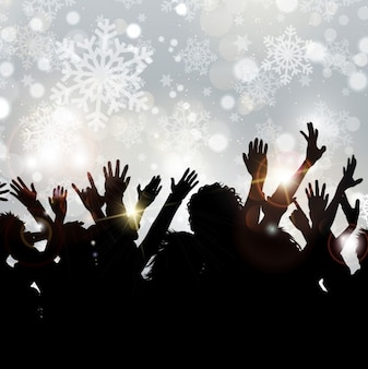 Crowd silhouettes on snowflake background