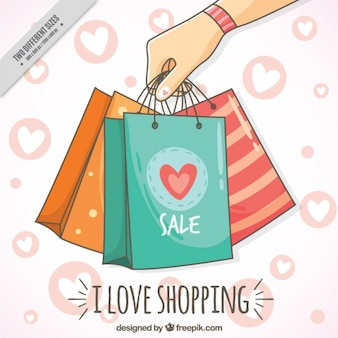 Cute background with shopping bags and hearts