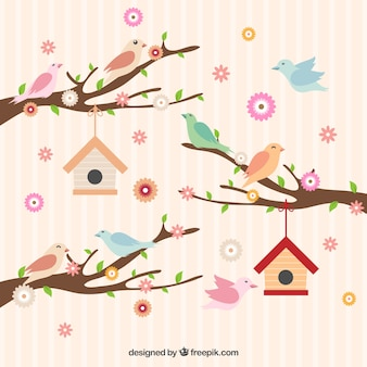 Cute birds on a branches with flowers