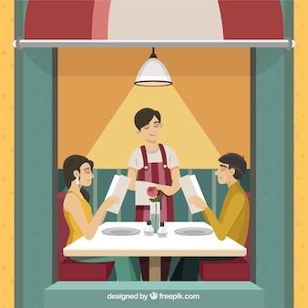 かわいいカップルは、食事を食べるレストランで