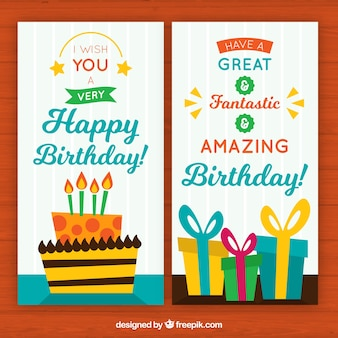 Cute greeting cards with birthday cake and presents