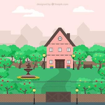 Cute pink house in a big garden