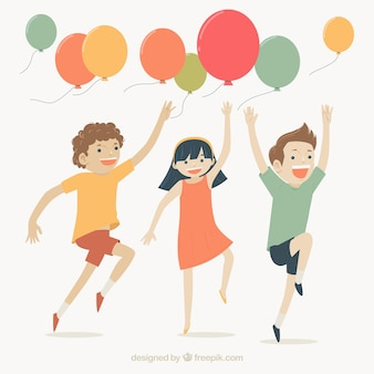 Cute scene of smiling children playing with balloons