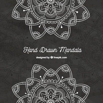 Dark background of hand drawn mandalas