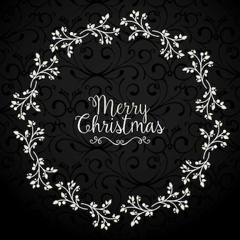Dark background with a floral wreath for christmas