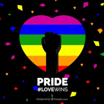 Dark background with colorful pride day heart