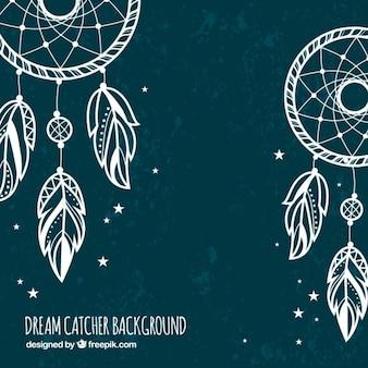 Dark background with white dream catchers