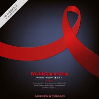 Dark blue background with red ribbon for world cancer day