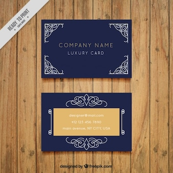 Dark blue business card with decorative ornaments