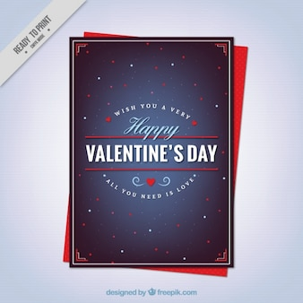 Dark blue valentine's card with white and red shapes