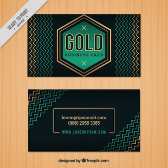 Dark business card with golden and green details