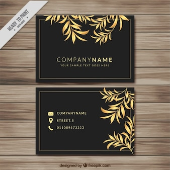Dark business card with golden leaves