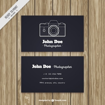 Dark business card with hand drawn camera
