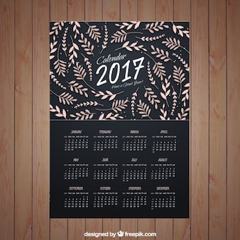 Dark calendar of 2017 with cute leaves decoration