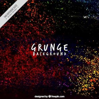 Dark grunge background with paint splatter