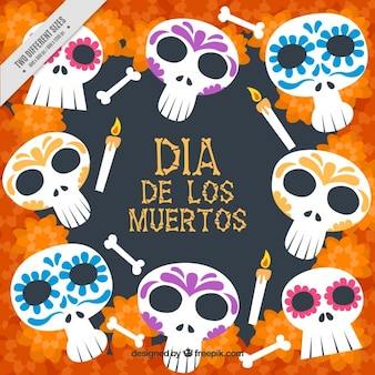 Day of the dead background of mexican skulls and candles
